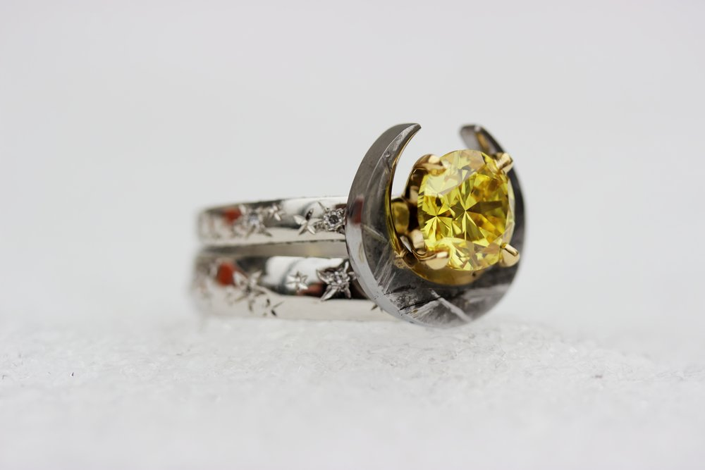 The Atlantides and Eclipse Rings have secret pavé on both edges of each ring, with a total of 200 graduated diamonds. The meteorite was polished on the inner edge to reflect the yellow diamond's warm glow.