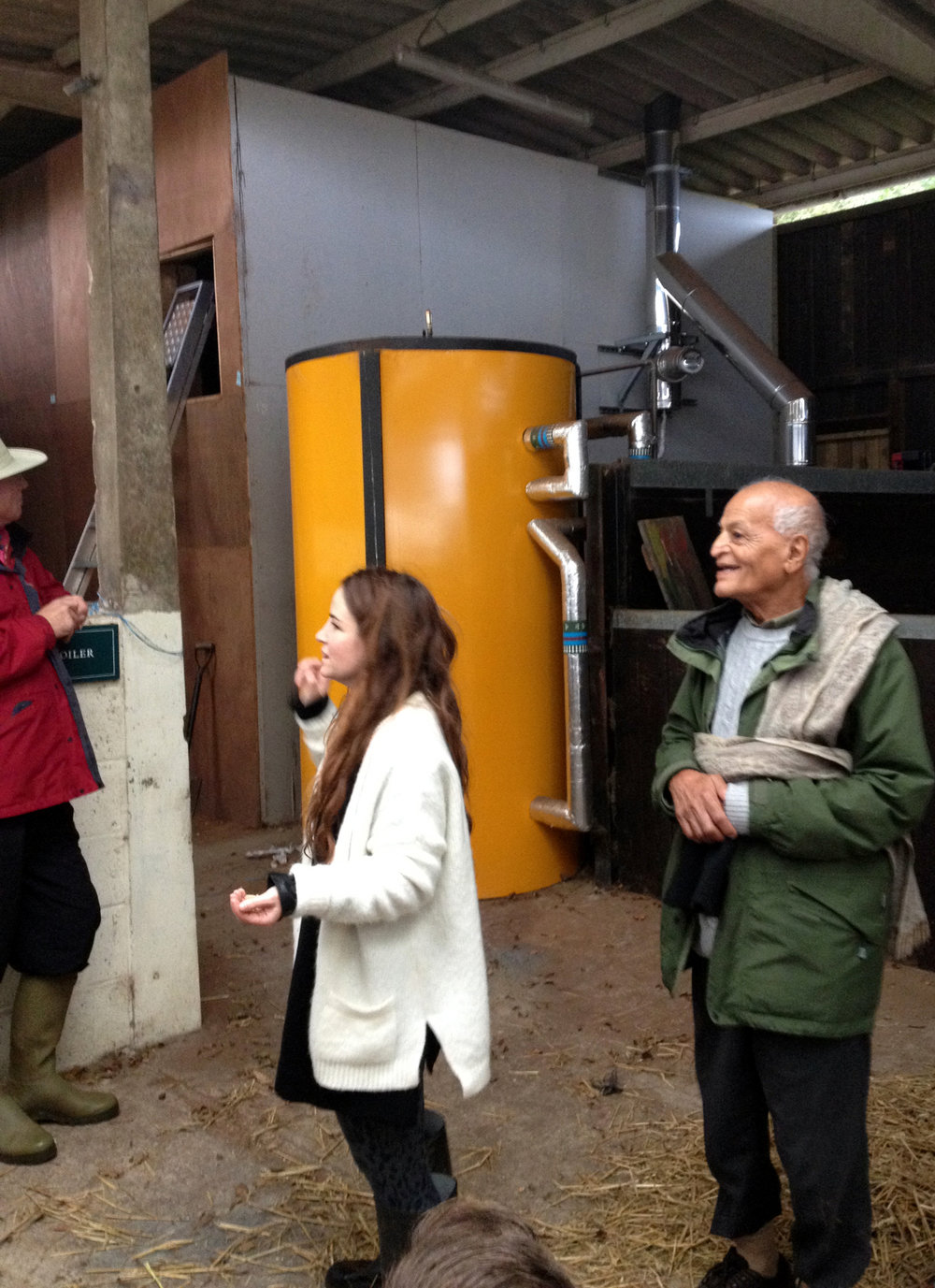 42 Acres founder, Lara showing us the biomass boiler