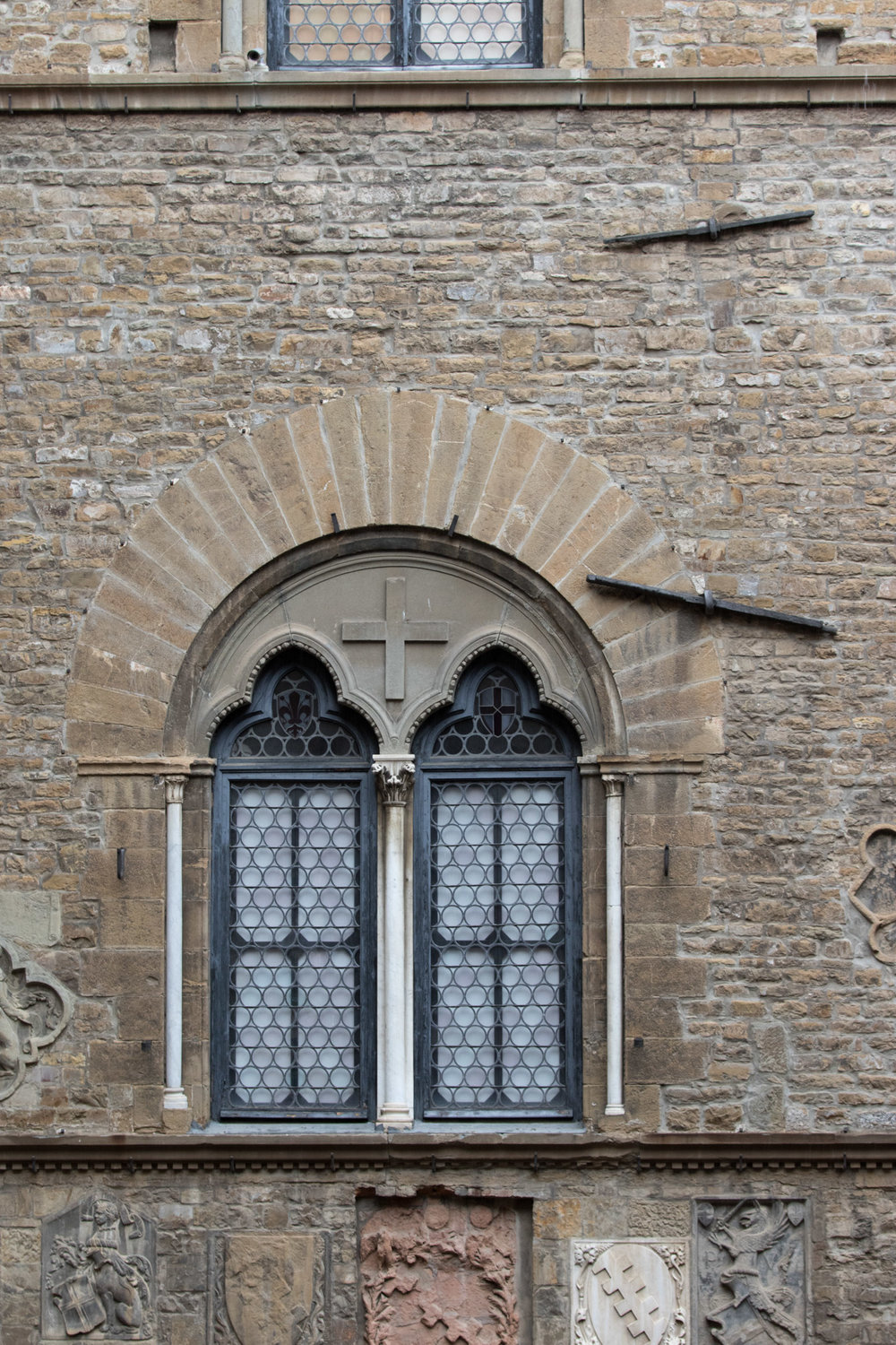 One of the many arched windows seen from inside the Bargello courtyard