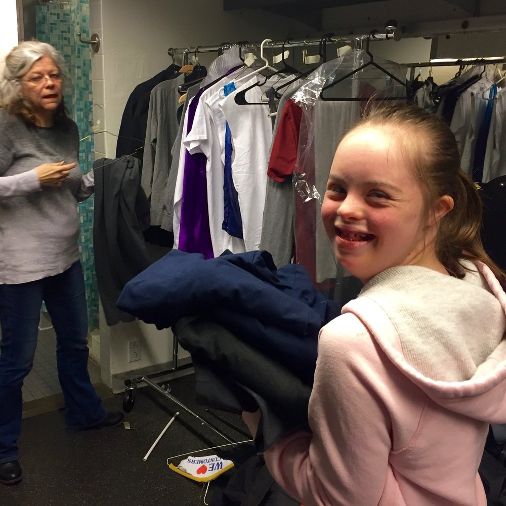 Charlotte, Costume Apprentice, and Kelly Hart, Seamstress, getting costumes ready for showtime.