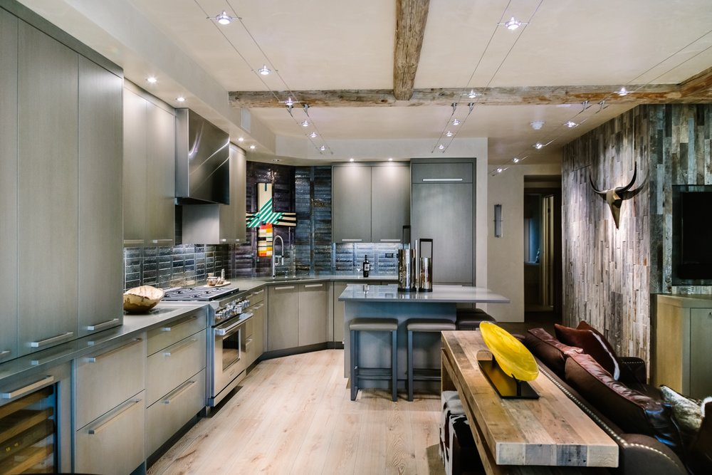 Modern Grey Slab L Shape Kitchen With Island | Custom Cabinets In Vail |  Timeless