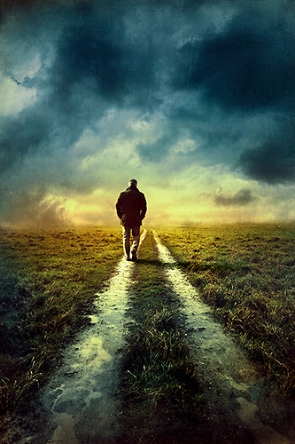 Man-walking-on-deserted-track.jpg