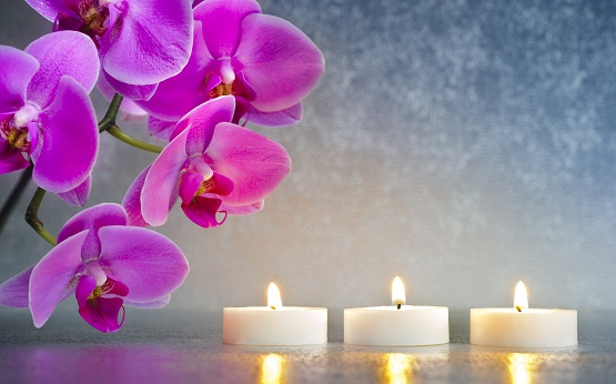 Candle-light-shine-and-purple-flowers.jpg