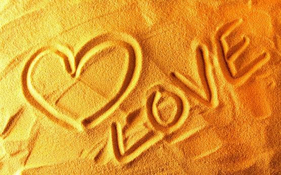 7038583-love-heart-sand.jpg