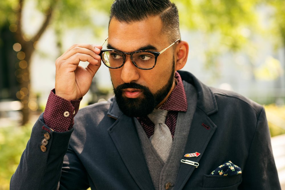Look #1: Suited  Incorporating eyeglasses with the professional look will turn heads and come off as sharp and well put-together. It's an accessory that can add class to your outfit at work, depending on the glasses frame and the way it shapes your facial structures.