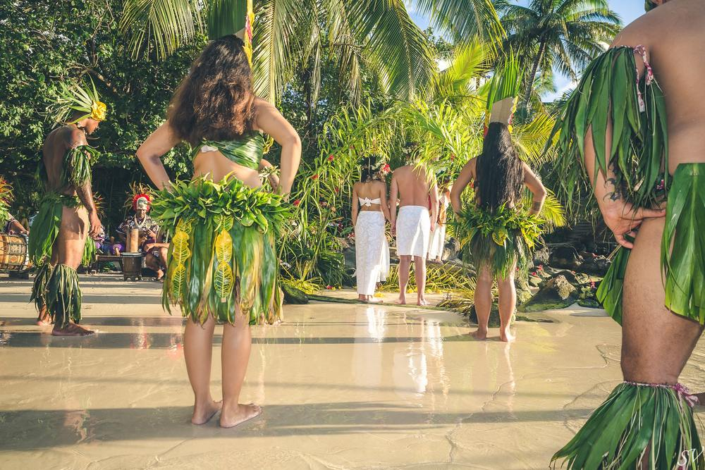 Polynesian wedding into the private beach