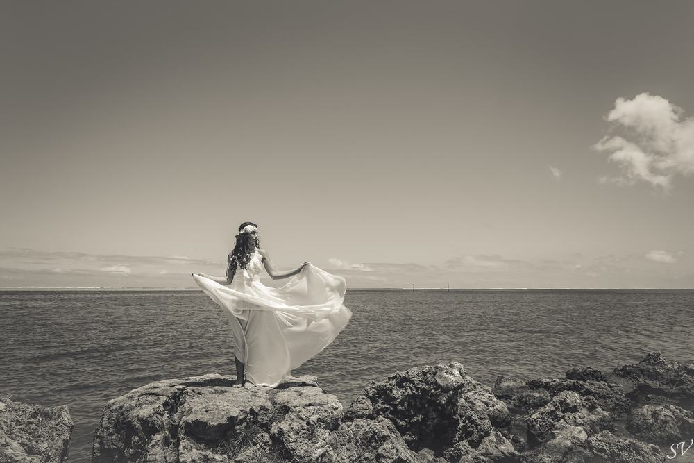 Beautiful bride with wedding dress into the wild