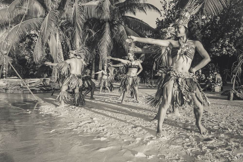 Polynesian dancers during a private elopement on the beach