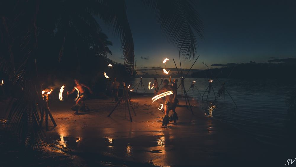 Fire dancing show during the wedding on the beach