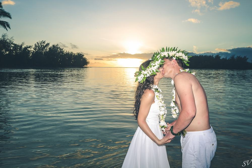 Bride and groom during the sunset trash the dress