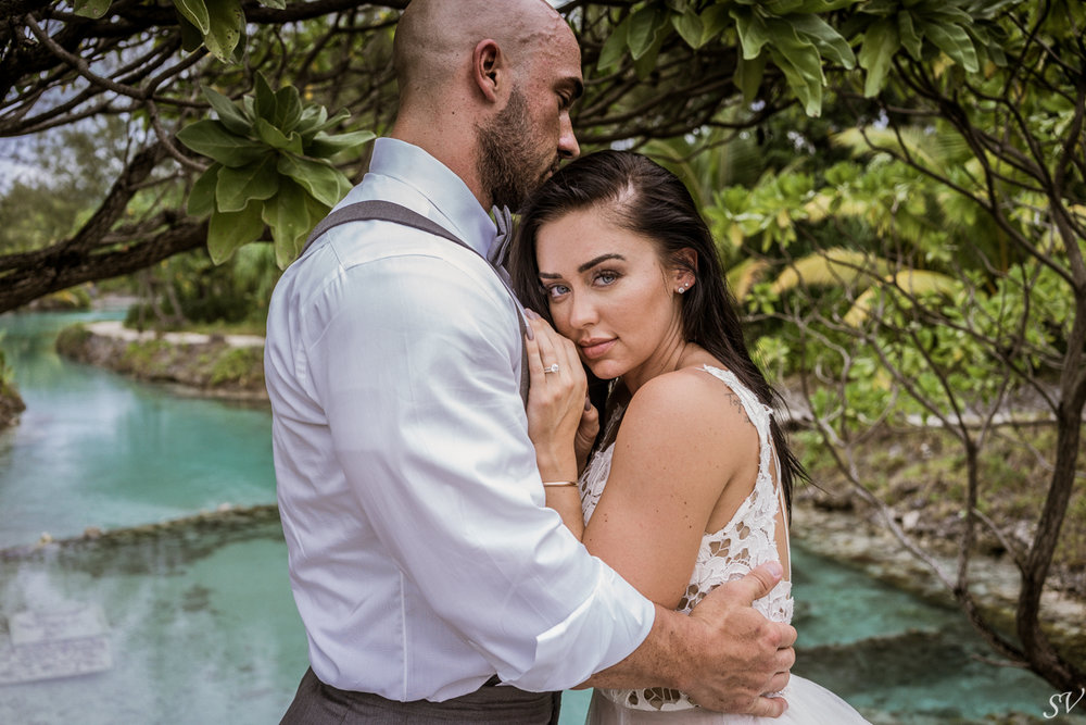 Katy Hearn and her husband Haydn. - Beautiful and fascinating fitness athletes choose the tropical and turquoise lagoon for their honeymoon and we have the pleasure to make their trash the dress session from their overwater suite.http://www.instagram.com/katyhearnfit