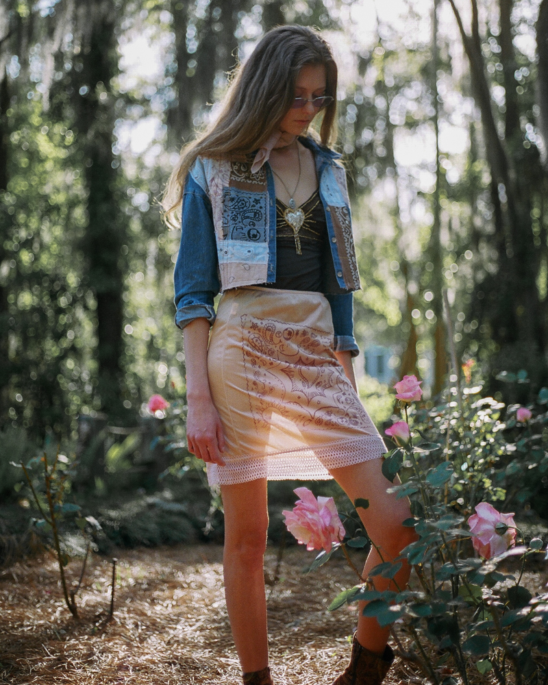 Bandana patchwork jacket. Jacket features vintage, naturally dyed, and custom screen printed bandannas. Naturally dyed and screen-printed silk skirt.