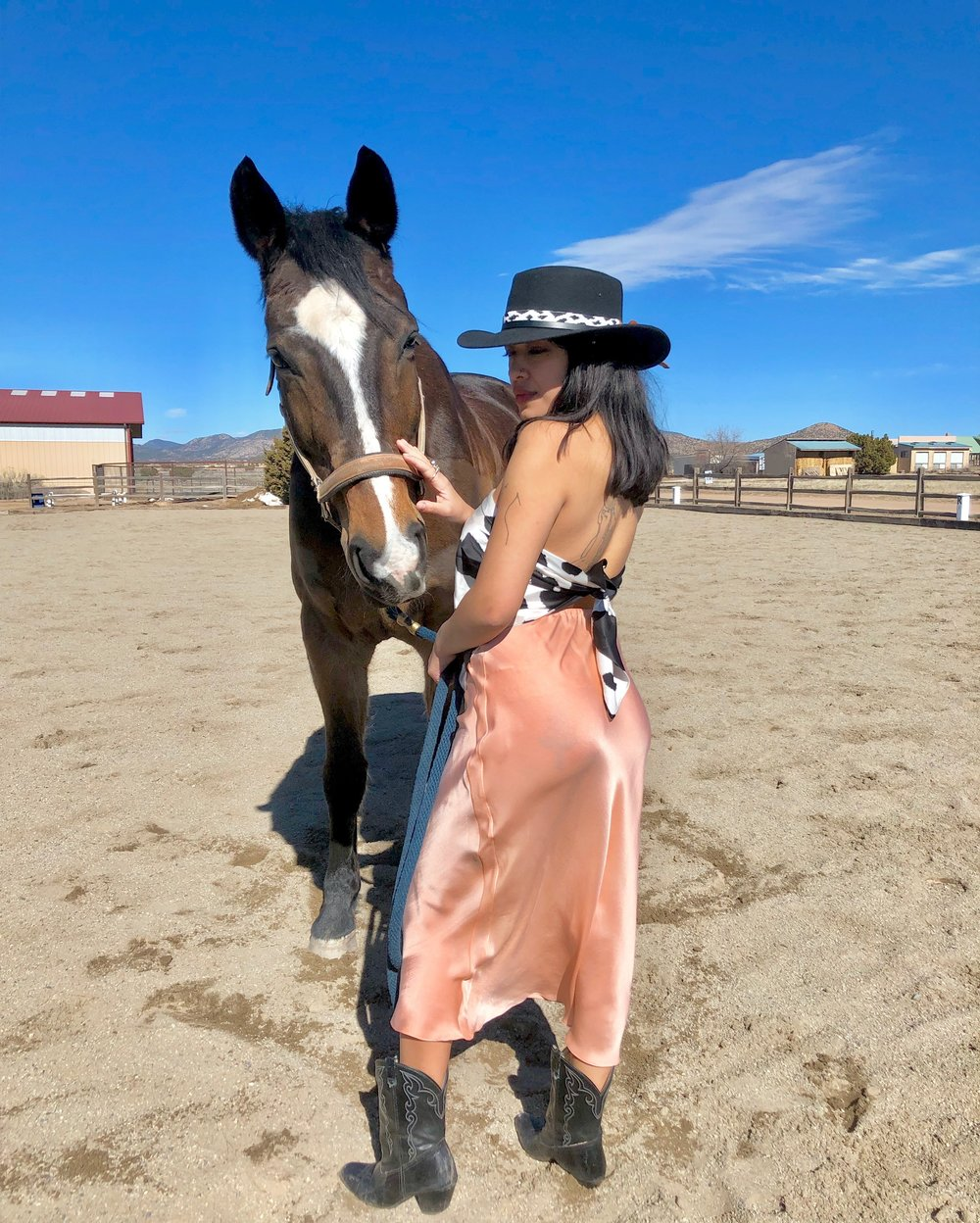 """'Pearl Hart Skirt""""' designed and naturally dyed by me, sewn by Sylvia Garcia. 'Cattle Queen Hat Band' hand beaded by me. Vintage cow print scarf."""
