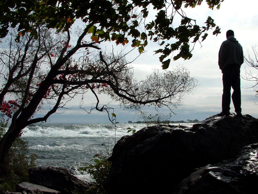 man-standing-by-river-1410523.jpg