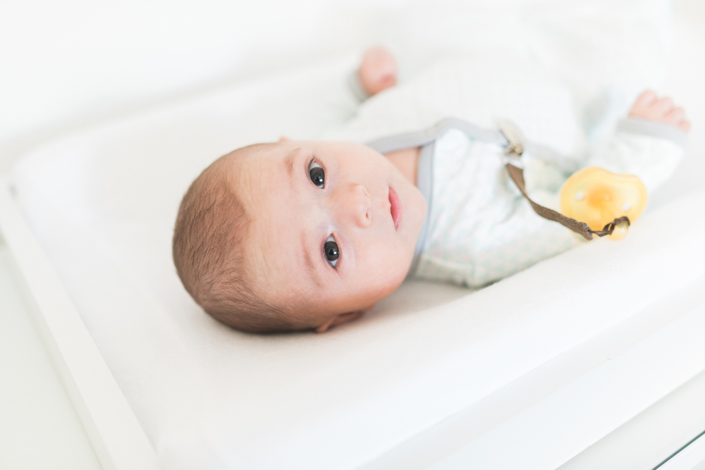 West Elm Inspired Newborn Lifestyle Session | Lynchburg Photographer | Kelsey & Nate | kelseyandnate.com | Gold Bird Mobile | Modern Nursery | White Nursery and Velvet Blue Rocker | Modern Burlap