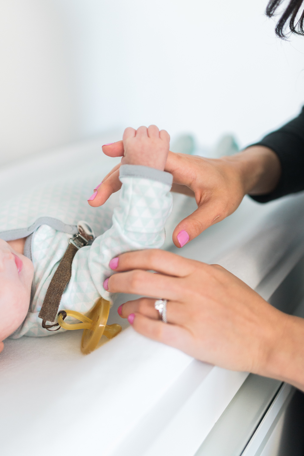 West Elm Inspired Newborn Lifestyle Session | Lynchburg Photographer | Kelsey & Nate | kelseyandnate.com | Gold Bird Mobile | Modern Nursery | White Nursery and Velvet Blue Rocker | Modern Burlap