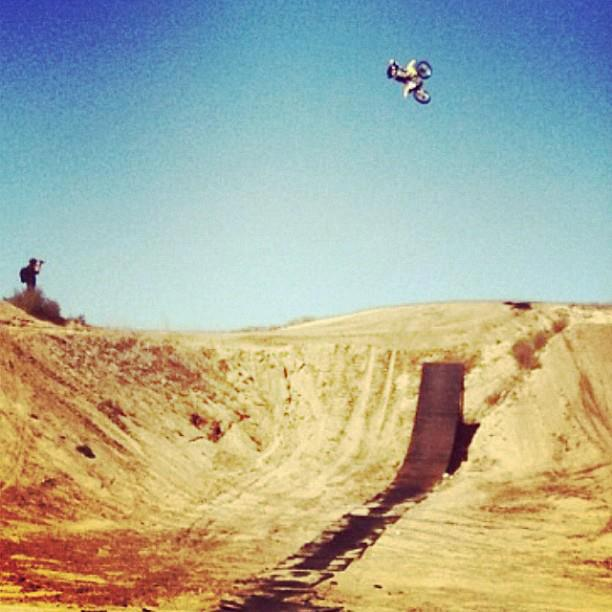 Josh Hansen roasting it up on a bike borrowed from Pro Surfer Sunny Garcia.