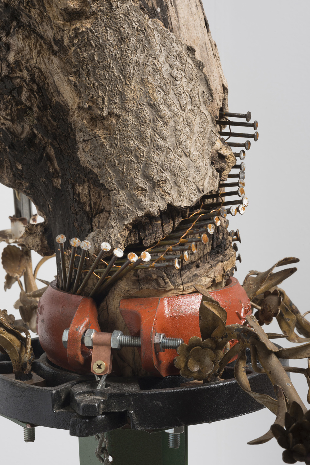 Lorna Williams-spoils-2013-chandelier fixtures, table legs, concrete, chain, plumbing hardware, Spanish moss, ukulele, root system, nails, wasp hive, acrylic, bullet casings-45x20x29-detail-4(2).jpg