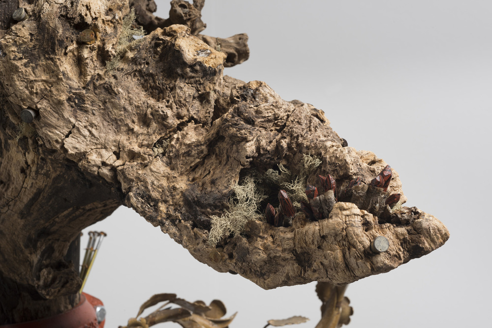 Lorna Williams-spoils-2013-chandelier fixtures, table legs, concrete, chain, plumbing hardware, Spanish moss, ukulele, root system, nails, wasp hive, acrylic, bullet casings-45x20x29-detail-6(2).jpg