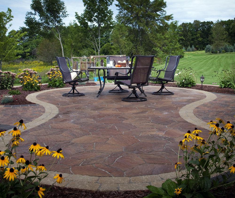 patio plantings paver hardscape landscape design colorful flowers