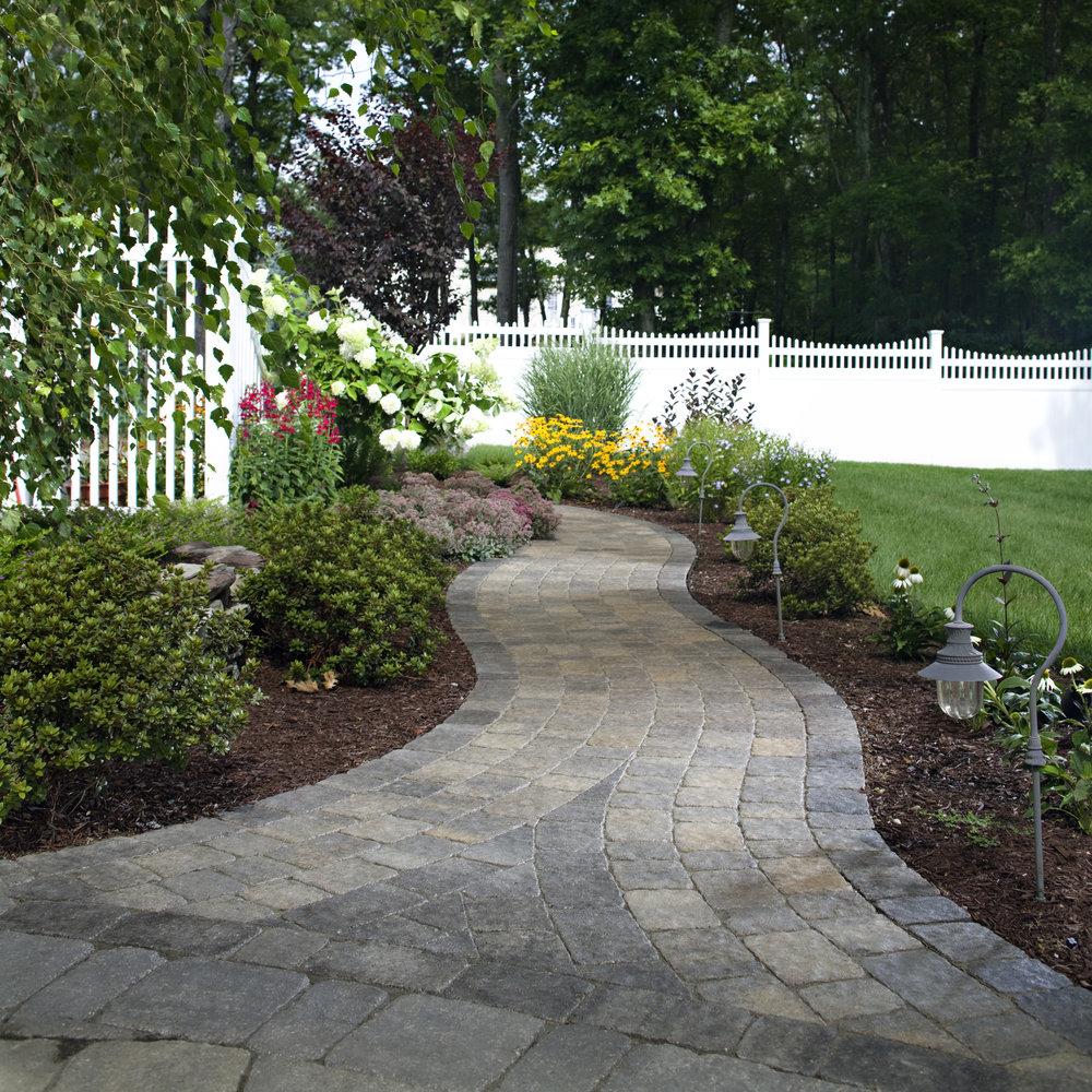 walkway pavers hardscape landscape design plantings landscape lights fence color