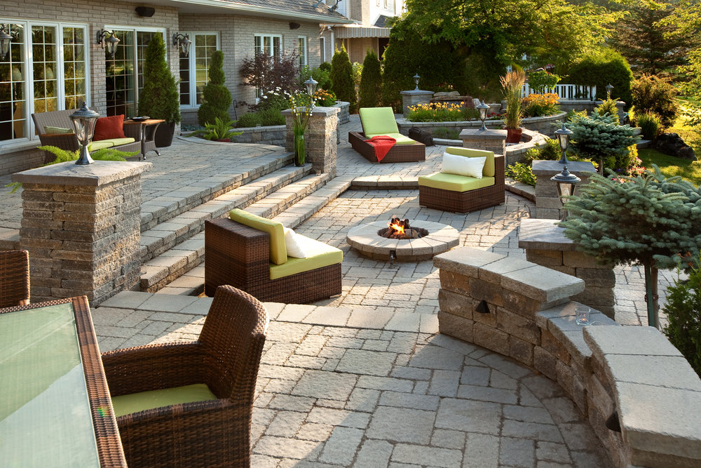 Patio landscape design hardscape walls pillars steps landscape lights backyard paradise fire pit outdoor kitchen