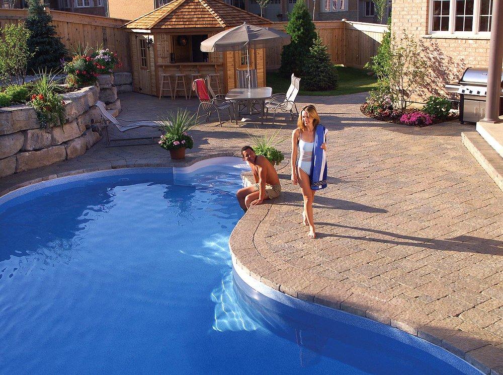 patio pool backyard paradise plantings landscape design hardscape pavers retaining wall