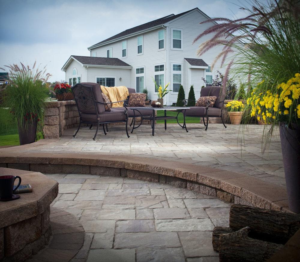 patio sitting wall hardscape landscape design fire pit backyard outdoor getaway outdoor room
