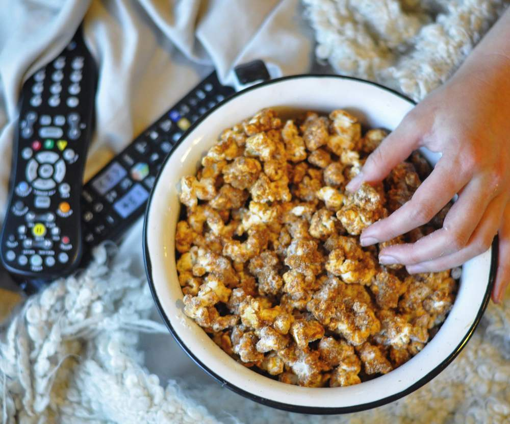 Unique Popcorn Recipe That's Great For Parties - Churro Popcorn - www.coupleinthekitchen.com - Couple in the Kitchen
