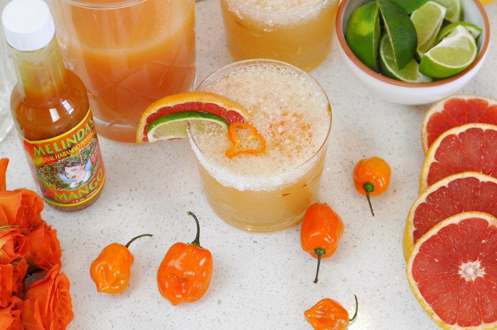 Spicy Paloma Cocktail Recipe with Mango Habanero | coupleinthekitchen.com