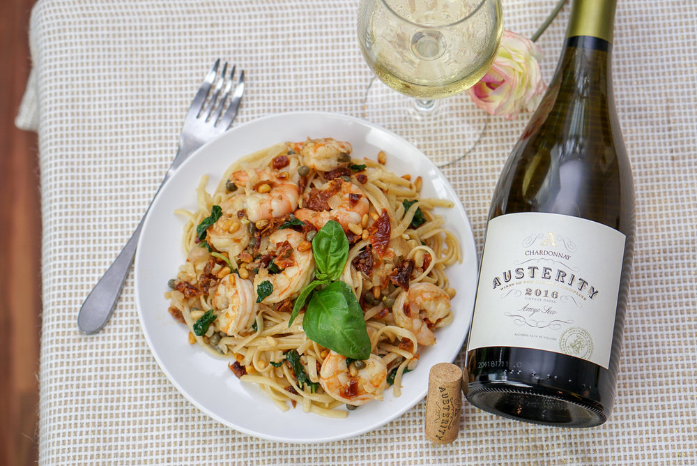 Sun Dried Tomato Pasta with Shrimp, Capers, Basil, and Pine Nuts | coupleinthekitchen.com