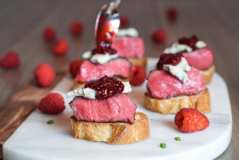 Blue Cheese Steak Appetizer with Raspberry Balsamic Sauce   coupleinthekitchen.com