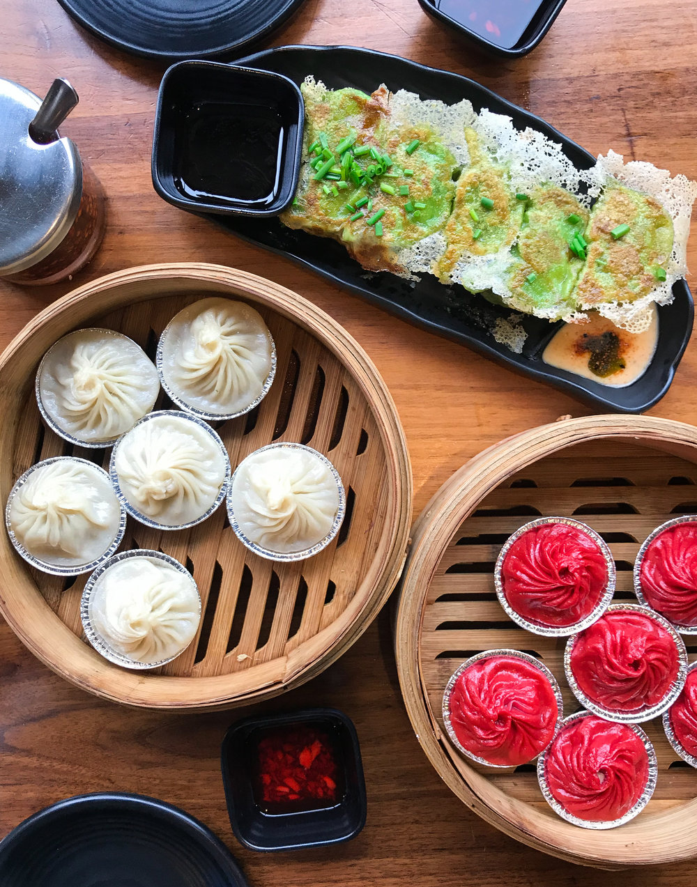 PLATES AND PLATES OF COLORFUL DUMPLINGS
