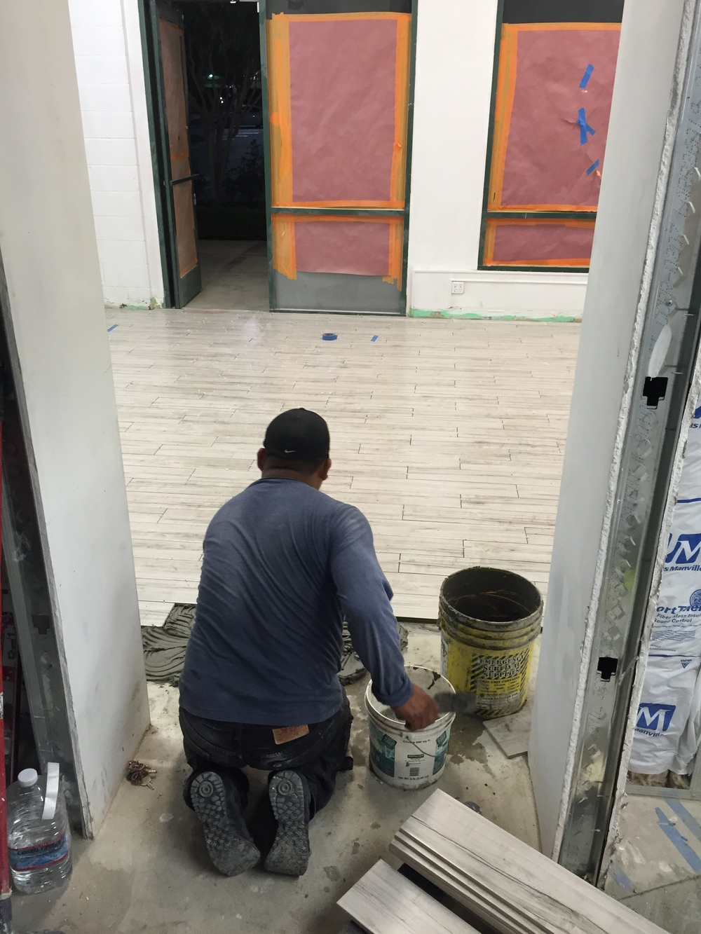 Finishing the tile in the front of house.