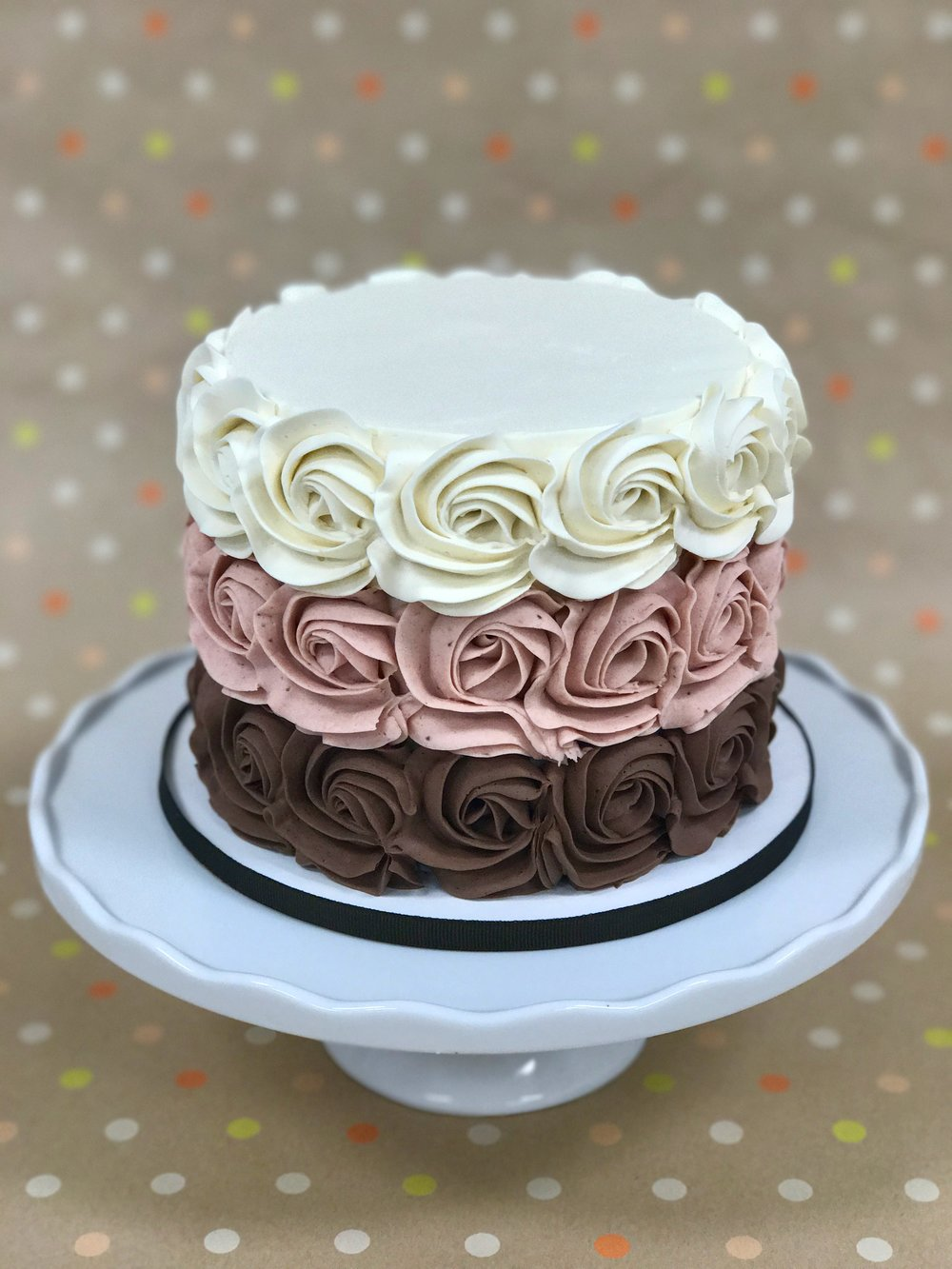 Neapolitan - Cake: Vanilla Bean and ChocolateFilling: Strawberry Swiss Meringue ButtercreamFrosting: Vanilla, Strawberry and Chocolate Swiss Meringue Buttercreams