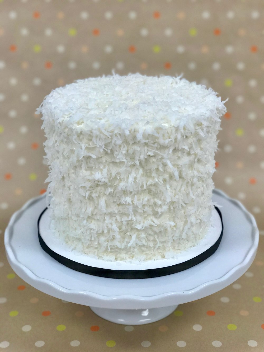 Coconut - Cake: CoconutFilling: Vanilla Cream CheeseFrosting: Vanilla Swiss Meringue Buttercream and Shredded Coconut