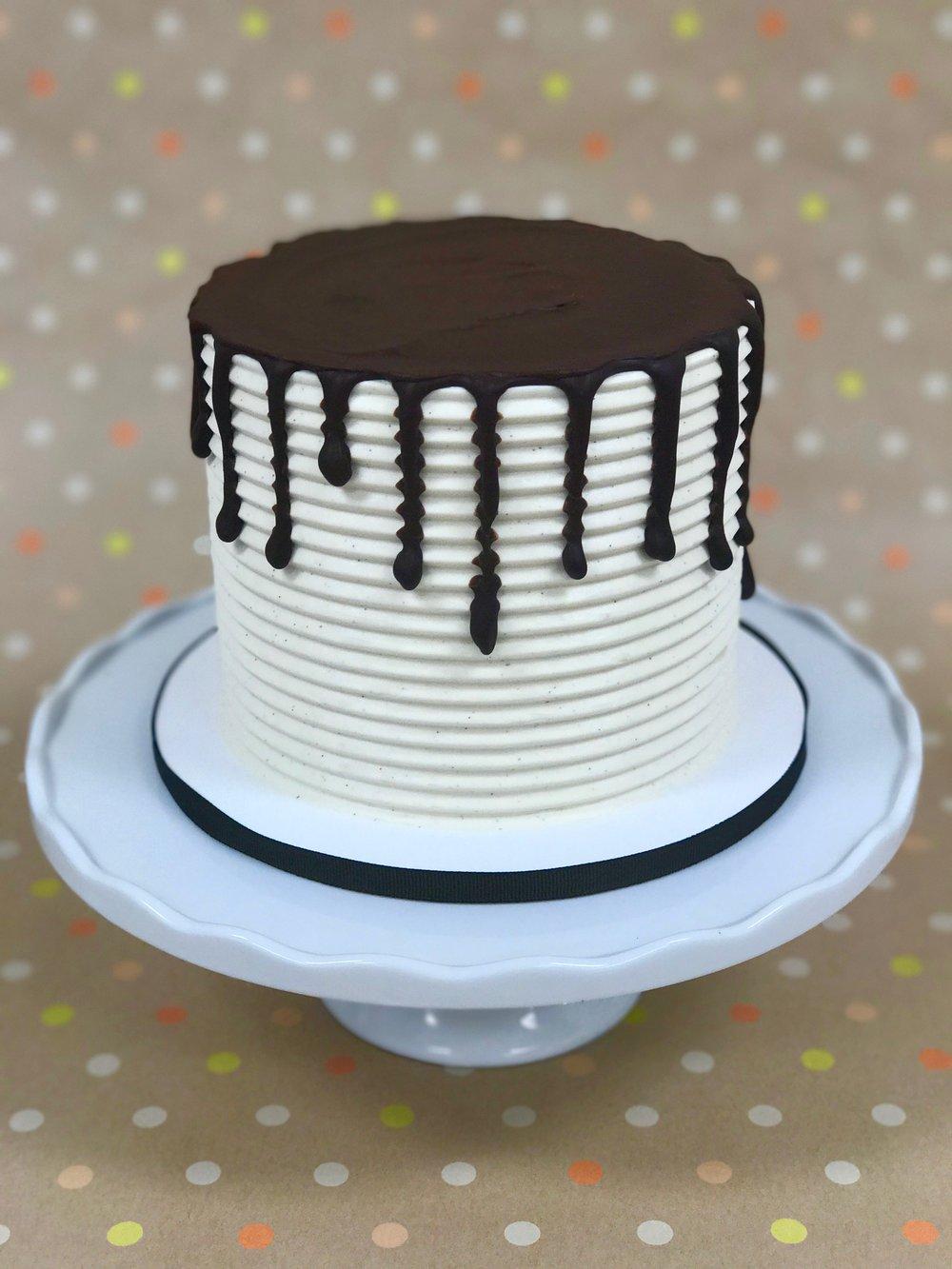 Black And White - Cake: Vanilla Bean and ChocolateFilling: Vanilla Bean and Chocolate ButtercreamsFrosting: Vanilla Bean Swiss Meringue Buttercream and Dark Chocolate Ganache