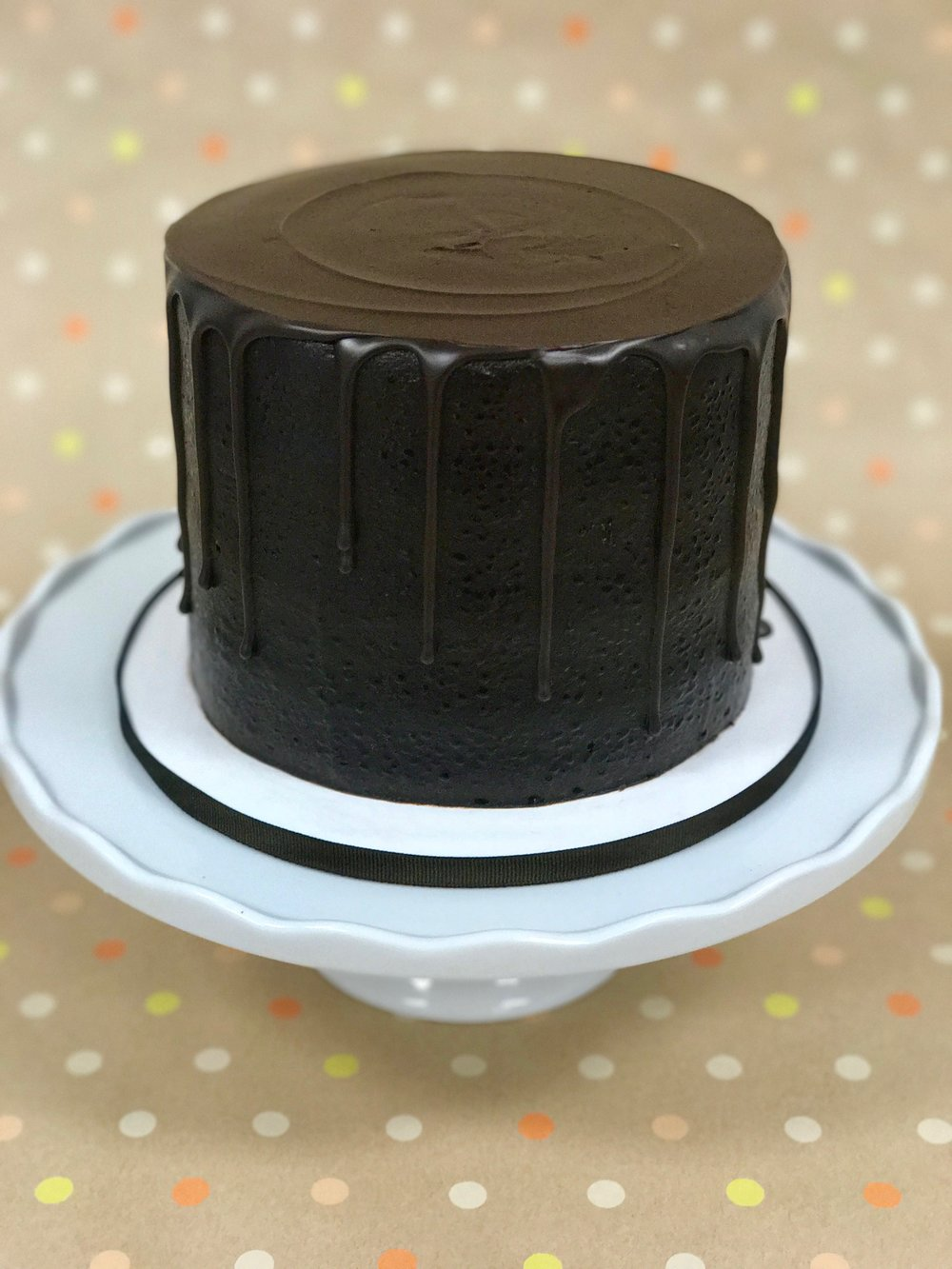 Triple Chocolate - Cake: ChocolateFilling: Chocolate FudgeFrosting: Chocolate Fudge and dark chocolate ganache