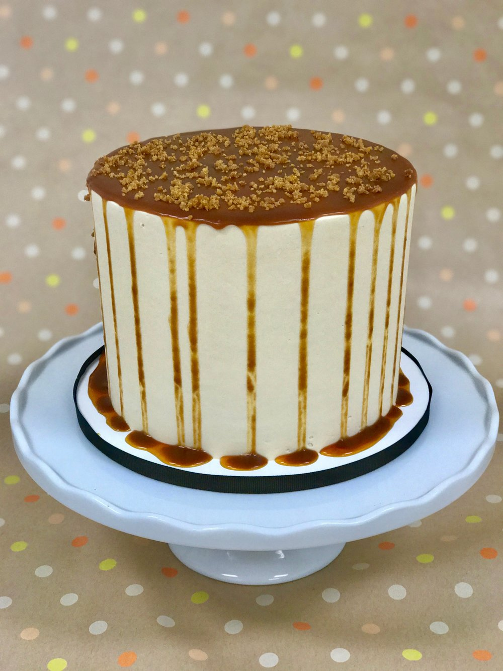 Salted Caramel Toffee - Cake: ToffeeFilling: Salted Caramel Swiss Meringue ButtercreamFrosting: Salted Caramel Swiss Meringue Buttercream, Salted Caramel Sauce and Toffee Bits