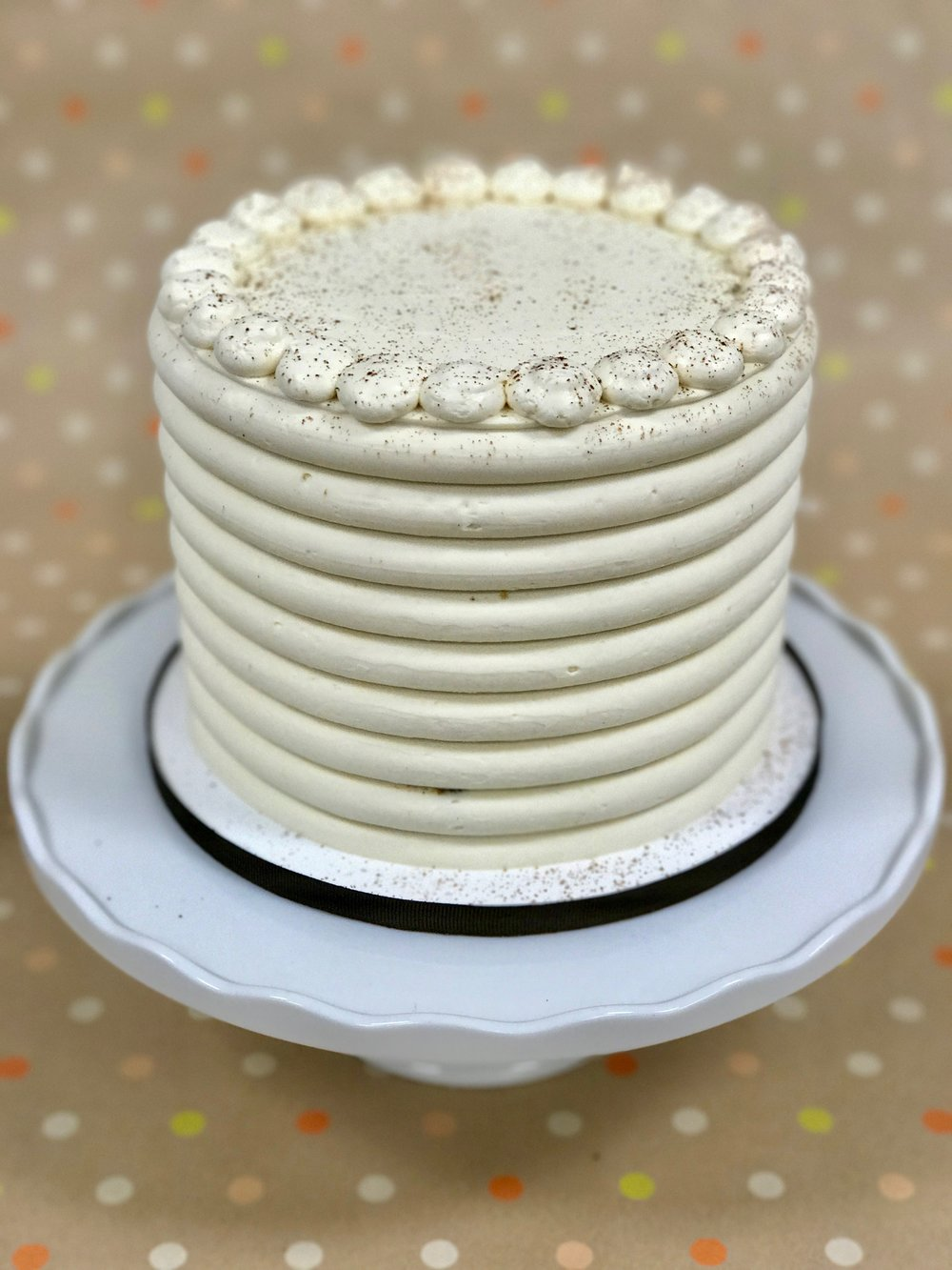 Carrot - Cake: Carrot Spice (no nuts or raisins)Filling: Vanilla Cream CheeseFrosting: Vanilla Swiss Meringue Buttercream and Dusted Cinnamon