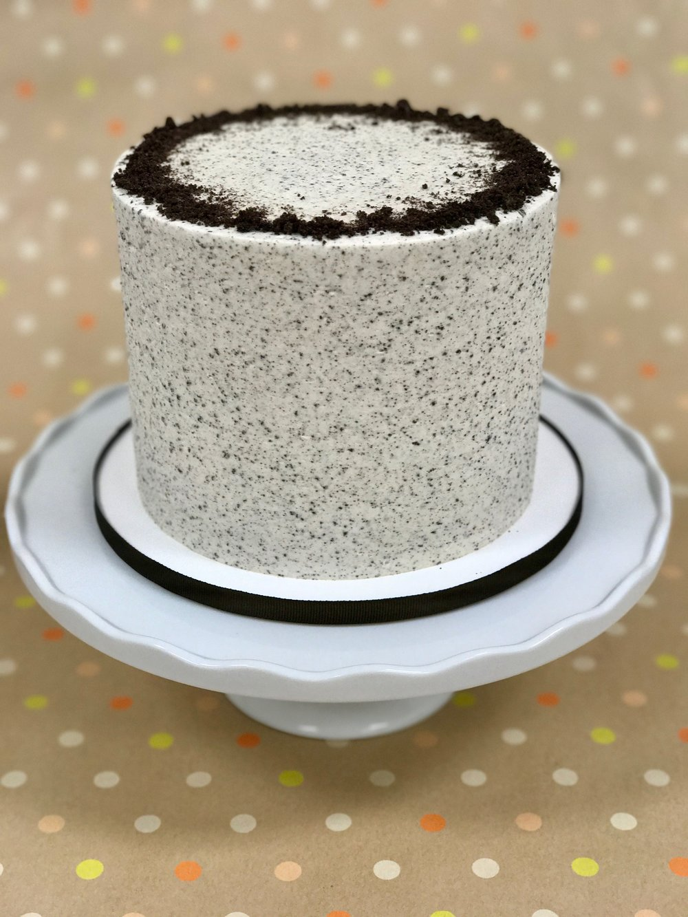 Cookies & Cream - Cake: Vanilla Bean with Crushed OreosFilling: Oreo Swiss Meringue ButtercreamFrosting: Oreo Swiss Meringue Buttercream and Crushed Oreos