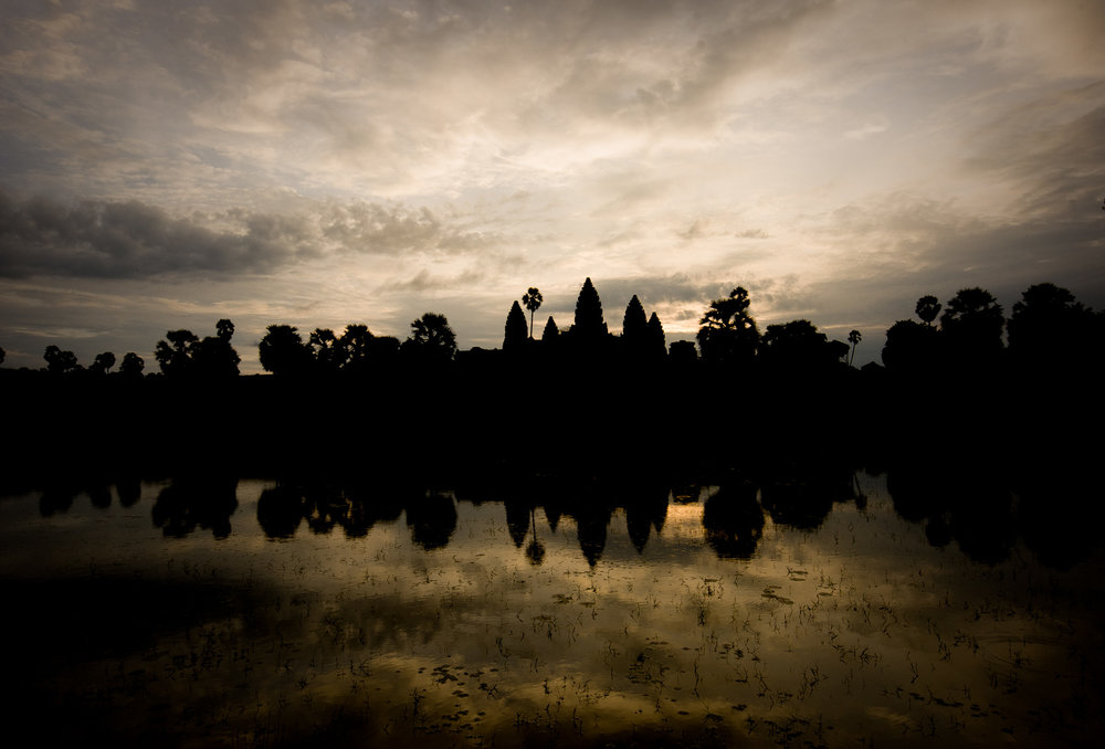 Watching the sunrise over the moat on arrival to Ang Kor Wat