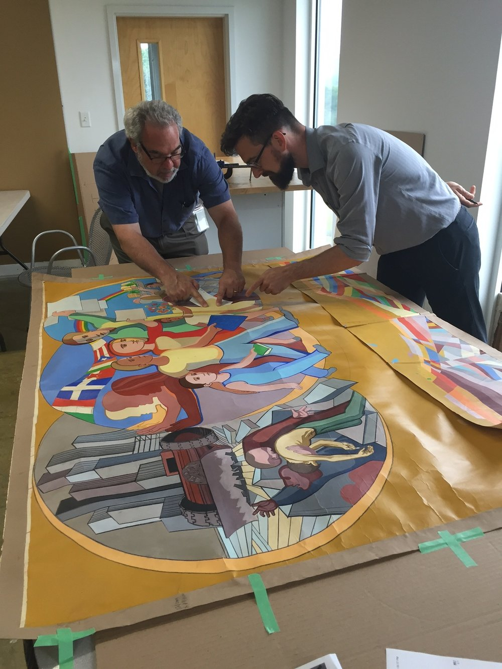 Golden Artist Colors' Mark Golden and Ulysses Jackson take color measurements from the original 1973 Arnold Belkin color rendering. Next step is the mixing of 63 color matches.