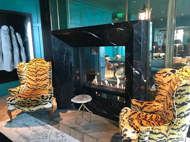 The hangout room in the Harrison doesn't just have amazing views of the Bay Bridge. It also rocks this Ken Faulk designer fireplace with tiger chairs. I could live here! #401Harrison #theharrison #movingyoutowhatsnext #southbeachliving #sfrealestate #sfcondo