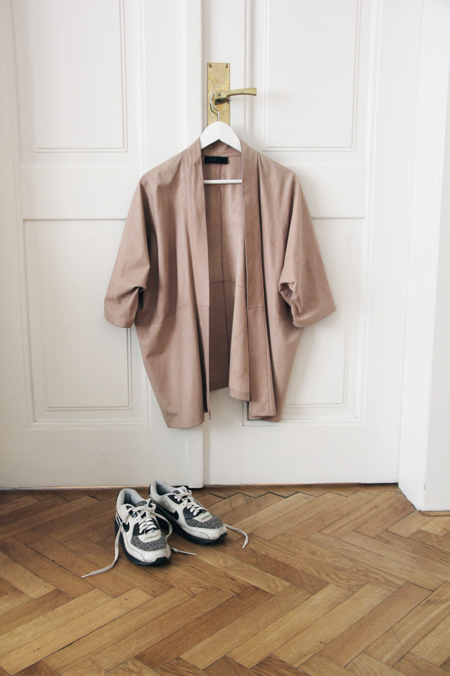Jacket by  VSP and  sneakers  by  Nike .