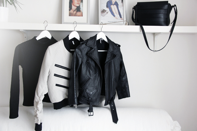 From left to right: turtleneck by Cooperative, white bomber jacket by Faith Connexion, leather jacket by H&Mand handbag by & Other Stories.