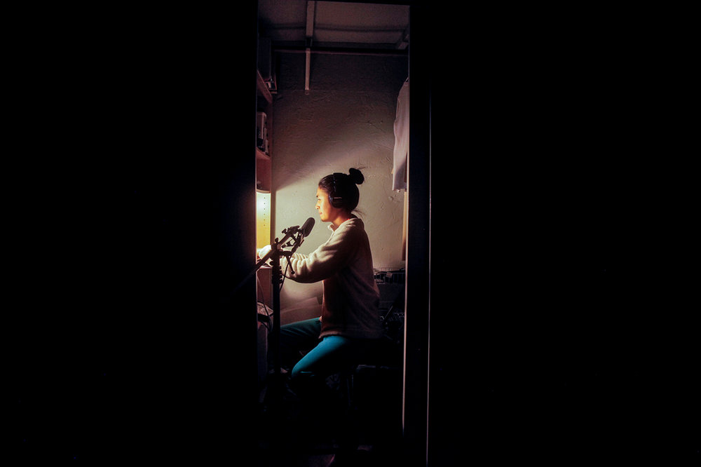 Pictured: Megan Tan recording in closet. Photo supplied.