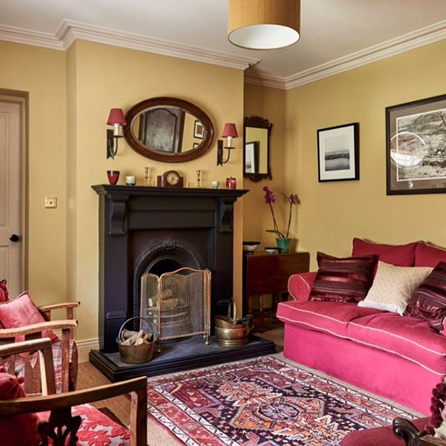 Sitting room walls in Paint and Paper Library Tile V, accents of reds and fuchsia from the sofa, lampshades and cushions. Reclaimed fireplace, antique rugs and furniture. #cottagestyle #cottage #livingroom #lounge #interior #interiors #livingroomdecor #paintandpaperlibrary #fireside #interiordecor