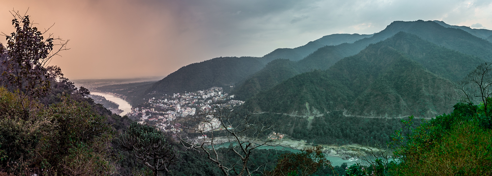 View of the Tapovan neighborhood of Rishikesh and the Ganges snaking through the foothills of the Himalayas.