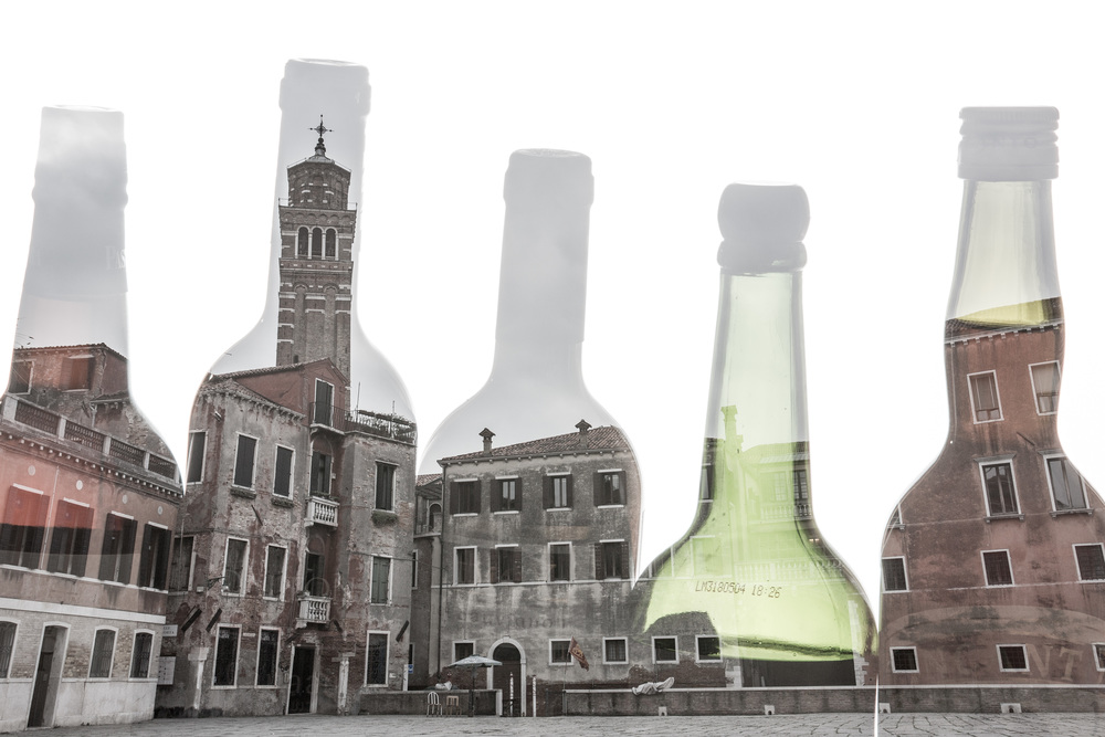 Multiple exposure of Venice and wine bottles. The Basilica di Santa Maria Gloriosa dei Frari can be seen in the second bottle from the left.